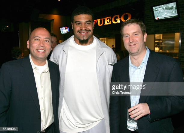 Jimmy Lynn Shawne Merriman of the San Diego Chargers and Ross Schaufelberger pose for a photograph at the Fantasy Sports Association reception at the...