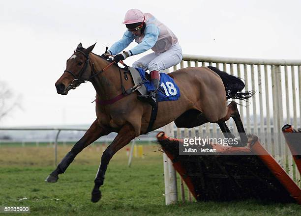 Jimmy Macarthy and United clear the last flight before landing The Hemingford Grey Maiden Hurdle Race run at Huntingdon Racecourse on February 24...