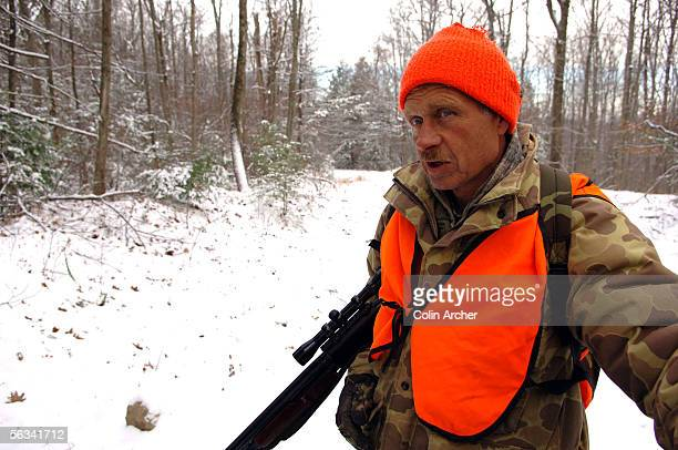 Jimmy Mancuso of Woodstown NJ takes a break from hunting on the first day of the hunt in the Waywayanda State Park December 5 2005 near West Milford...