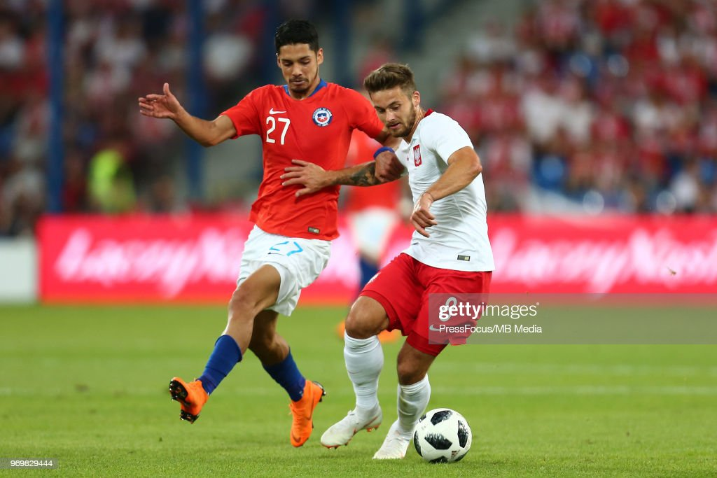 Jimmy Martinez of Chile competes with Karol Linetty of Poland during International Friendly match between Poland and Chile on June 8, 2018 in Poznan, Poland.