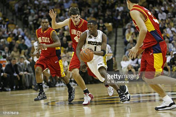 Jimmy McKinney of the Missouri Tigers drives down the lane during 1st half action against the Iowa State Cyclones at Mizzou Arena in Columbia...