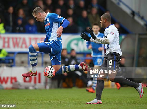 Jimmy McNulty of Rochdale tackles Leon Clarke of Bury during The Emirates FA Cup Second Round match between Rochdale and Bury at Spotland on December...