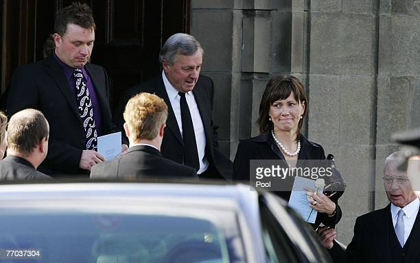 Jimmy McRae, father of Colin McRae and Alison McRae, wife of Colin McRae leave the funeral of Colin McRae and son Johnny at East Chapel, Daldowie...