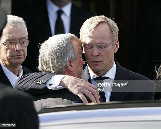 Jimmy McRae, father of Colin McRae is hugged by Ari Vatanen as they leave the funeral of Colin McRae and son Johnny at East Chapel, Daldowie...
