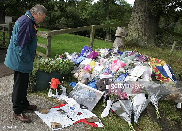 Jimmy McRae father of former rally world champion Colin McRae looks at flowers and tributes left for his son at the family home in Lanark in Scotland...