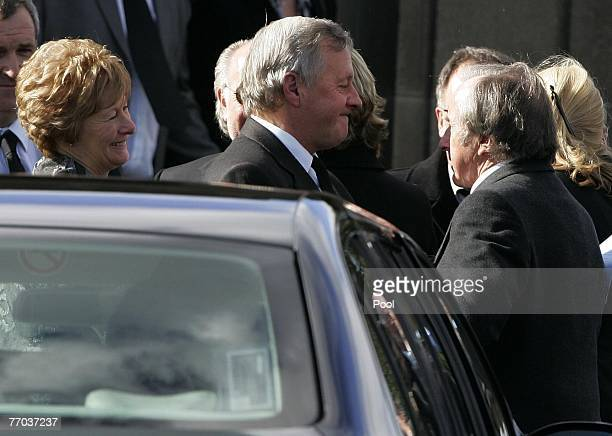 Jimmy McRae with his wife Margaret with Sir Jackie Stewart arriving for the funeral of Colin McRae and son Johnny at East Chapel, Daldowie...