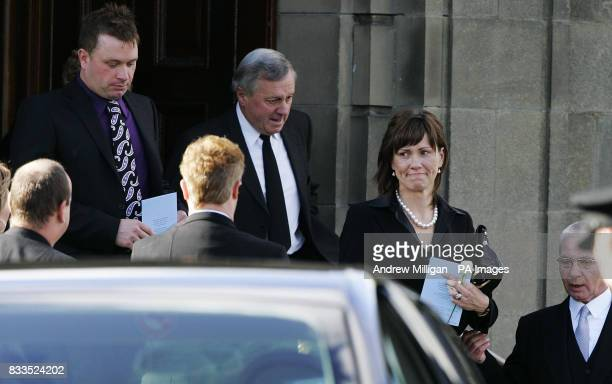 Jimmy McRrae with Alison McRae leave the funeral of Colin McRae and son Johnny at East Chapel, Daldowie Crematorium.
