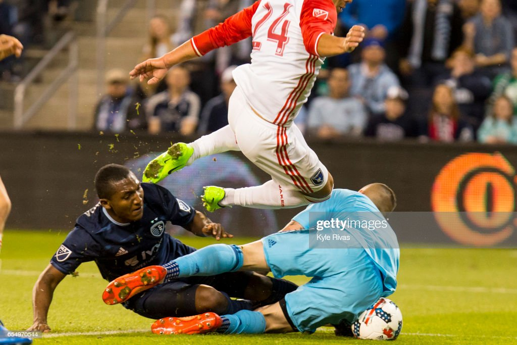 Jimmy Medranda #94 of Sporting Kansas City collides with David Bingham #1 and Nick Lima #24 of San Jose Earthquakes at Children's Mercy Park on March 18, 2017 in Kansas City, Kansas.