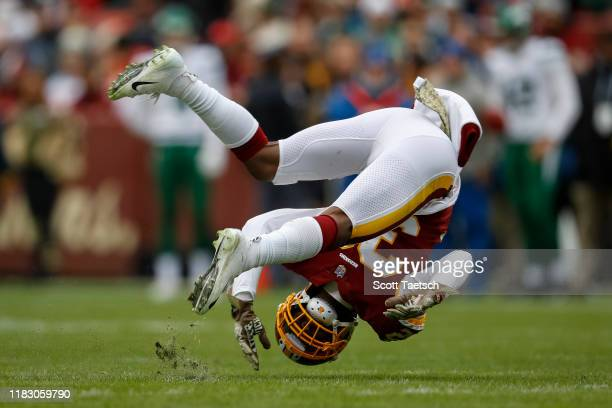 Jimmy Moreland of the Washington Redskins is upended against the New York Jets during the first half at FedExField on November 17 2019 in Landover...