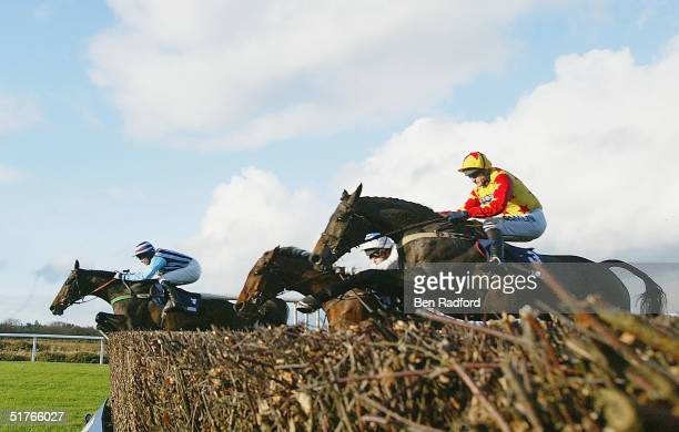 Jimmy Murphy riding Best Mate edges in front of A.Thornton riding Sir Rembrandt, during the The William Hill Steeple Chase on November 19, 2004 at...