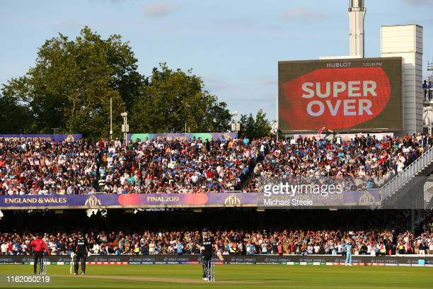 Jimmy Neesham and Martin Guptill of New Zealand prepare to bat in the Super-Over during the Final of the ICC Cricket World Cup 2019 between New...
