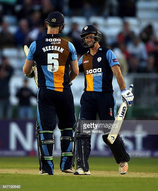 Jimmy Neesham and Wayne Madsen of Derbyshire Falcons react after the NatWest T20 Blast between Derbyshire Falcons and Lancashire Lightning at The...