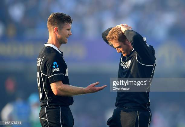 Jimmy Neesham of New Zealand and Martin Guptill of New Zealand react to their loss after the Final of the ICC Cricket World Cup 2019 between New...