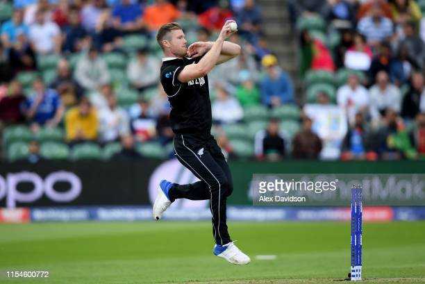 Jimmy Neesham of New Zealand bowls during the Group Stage match of the ICC Cricket World Cup 2019 between Afghanistan and New Zealand at The County...