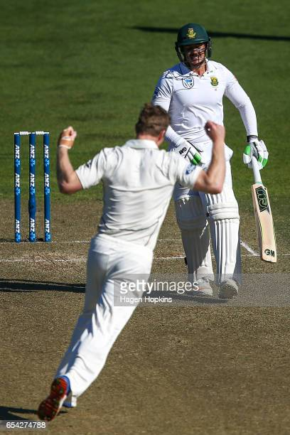 Jimmy Neesham of New Zealand celebrates after dismissing Quentin de Kock of South Africa during day two of the test match between New Zealand and...