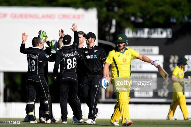 Jimmy Neesham of New Zealand celebrates taking the wicket of Aaron Finch of Australia during the Cricket World Cup One Day Practice Match between...