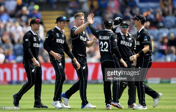 Jimmy Neesham of New Zealand celebrates the wicket of Isuru Udana of Sri Lanka with his teammates during the Group Stage match of the ICC Cricket...