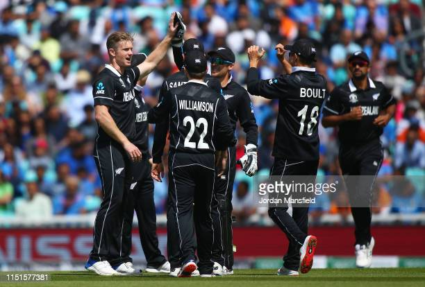 Jimmy Neesham of New Zealand celebrates with his teammates after dismissing Hardik Pandya of India during the ICC Cricket World Cup 2019 Warm Up...