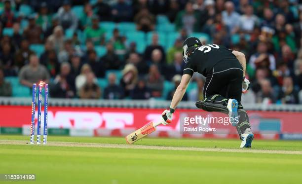 Jimmy Neesham of New Zealand narrowly makes it back to his crease during the Group Stage match of the ICC Cricket World Cup 2019 between Bangladesh...