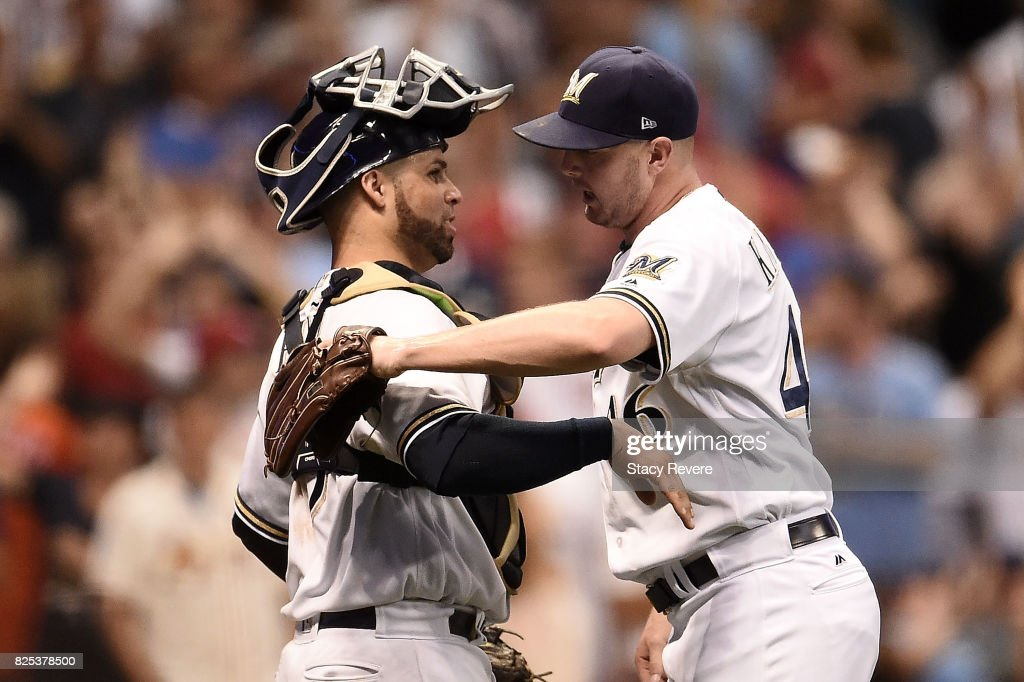 Jimmy Nelson #52 of the Milwaukee Brewers embraces Manny Pina #9 following a 3-2 victory over the St. Louis Cardinals at Miller Park on August 1, 2017 in Milwaukee, Wisconsin.