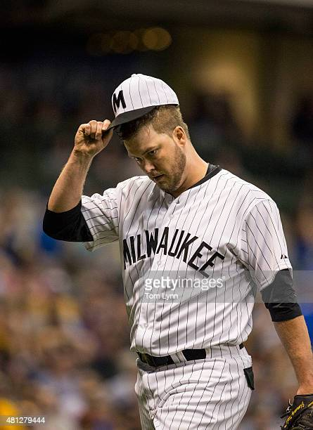 Jimmy Nelson of the Milwaukee Brewers tips his cap to the fans after being taken out of the game against the Pittsburgh Pirates in the sixth inning...