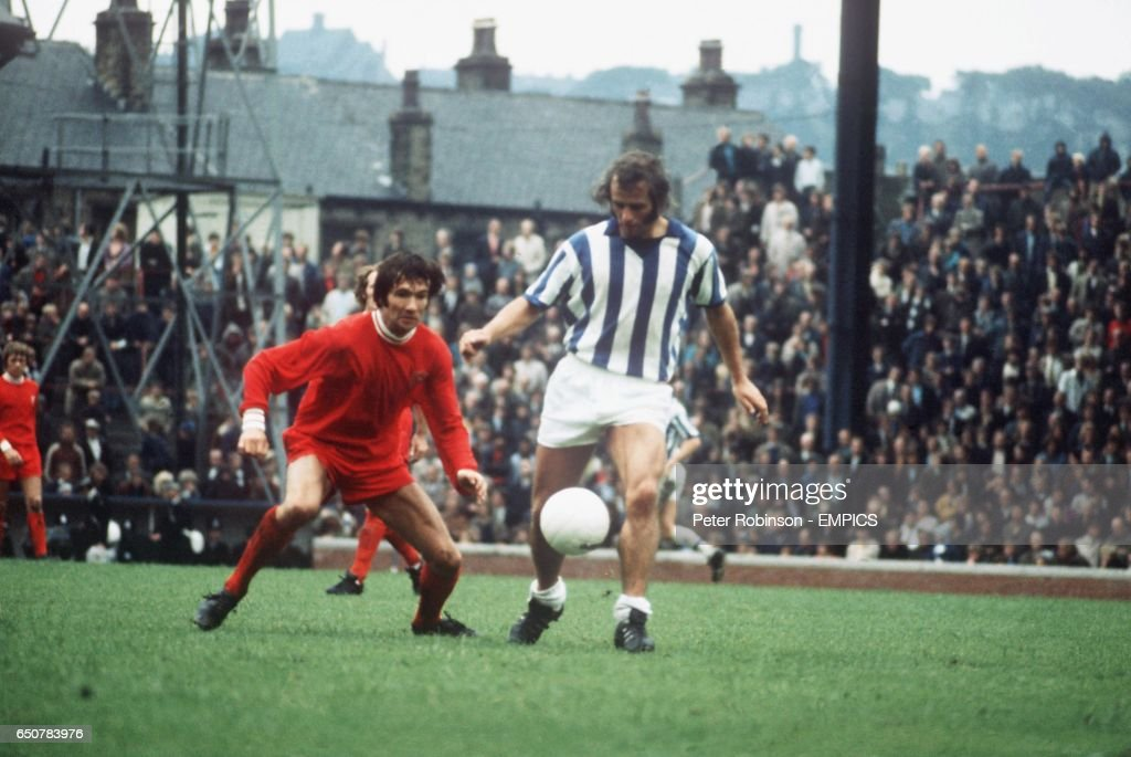 Jimmy Nicholson of Huddersfield Town (right) shields the ball from Leicester City's Jon Sammels
