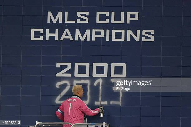 Jimmy Nielsen of Sporting Kansas City spray paints 2013 on the the championship wall after winning the MLS Cup Final against the Real Salt Lake at...