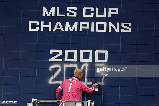 Jimmy Nielsen of Sporting Kansas City spray paints 2013 on the wall after they won the MLS Cup Final against Real Salt Lake at Sporting Park on...
