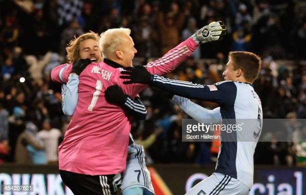 Jimmy Nielsen of Sporting KC celebrates with his teammates Chance Myers and Matt Besler after defeating Real Salt Lake in penalty kicks to win the...