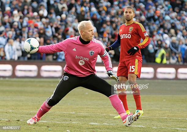 Jimmy Nielsen of Sporting KC clears the ball as Alvaro Saboru of Real Salt Lake looks on in the first half of the 2013 MLS Cup at Sporting Park on...