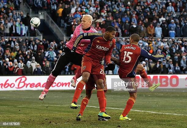 Jimmy Nielsen of Sporting KC makes a save against Chris Schuler and Alvaro Saboru of Real Salt Lake in the first half of the 2013 MLS Cup at Sporting...