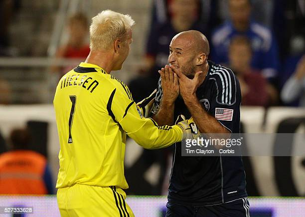 Jimmy Nielsen Sporting Kansas City Captain and Goalkeeper attempts to calm down team mate Aurelien Collin during the New York Red Bulls V Sporting...