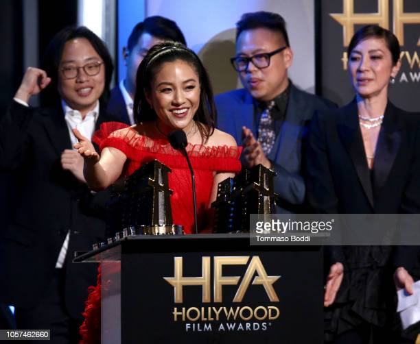 Jimmy O Yang Constance Wu Nico Santos and Michelle Yeoh accept the Hollywood Breakout Ensemble Award for Crazy Rich Asians onstage during the 22nd...