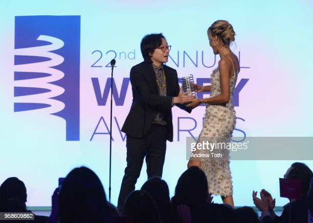 Jimmy O Yang presents award to Madison Utendahl onstage at The 22nd Annual Webby Awards at Cipriani Wall Street on May 14 2018 in New York City