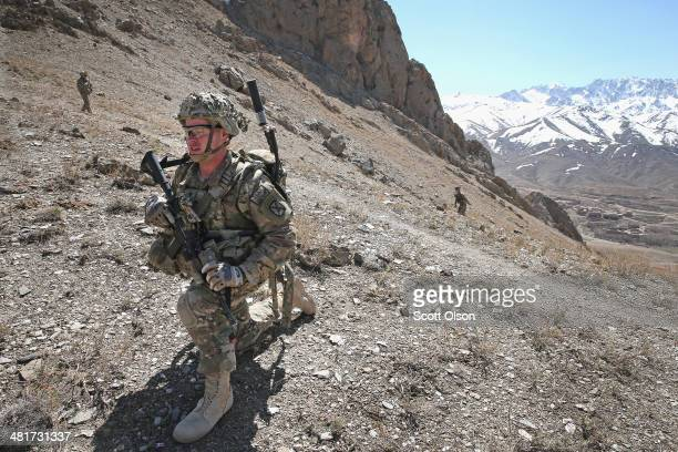 Jimmy Orrell from Claremore Oklahoma with the US Army's 2nd Battalion 87th Infantry Regiment 3rd Brigade Combat Team 10th Mountain Division patrols...
