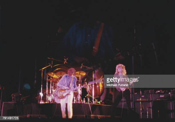 Jimmy Page and Robert Plant of English rock group Led Zeppelin perform live on stage at the Knebworth Festival at Knebworth House in Hertfordshire...
