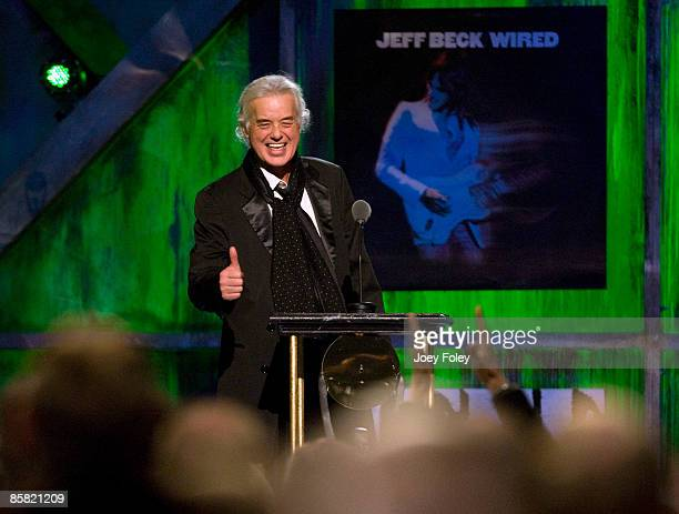Jimmy Page gives a thumbs up to the crowd as he gets a standing ovation on entering the stage to present an award during the 24th Annual Rock and...