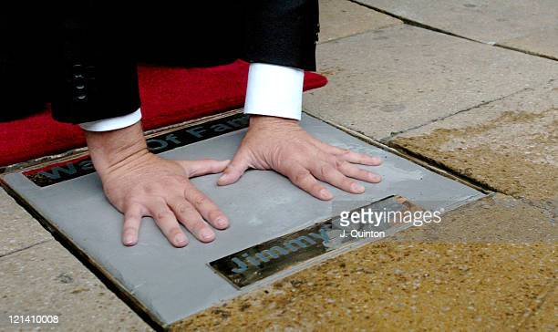 Jimmy Page handprints a paving stone outside the new Virgin Megastore at No 1 Piccadilly to launch London's 'Walk of Fame'