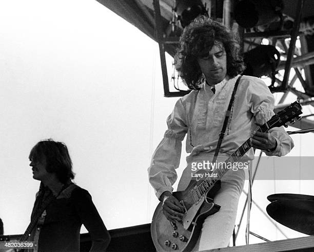 Jimmy Page is performing with Led Zeppelin at Kezar stadium on June 2 1973 in San Francisco California Photo by Larry Hulst/Michael Ochs...