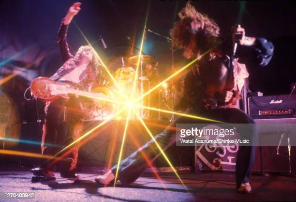 Jimmy Page , John Bonham , Robert Plant of Led Zeppelin performing on stage with Marshall amplifiers behind, at Earl's Court, London, May 1975.