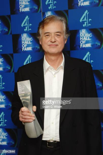Jimmy Page Led Zeppelin guitarist poses with their inductee trophy in the Awards Room at the UK Music Hall Of Fame 2006 at Alexandra Palace on...