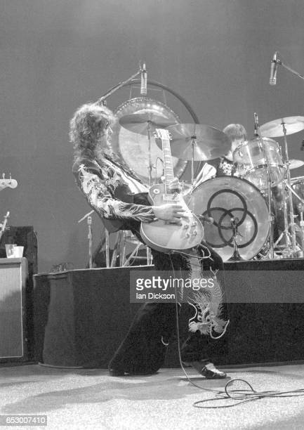 Jimmy Page of Led Zeppelin performing on stage at Earls Court London 17 May 1975
