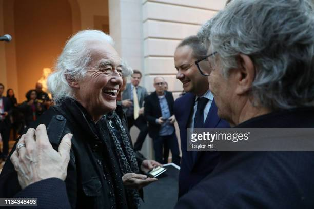 Jimmy Page of Led Zeppelin speaks with Steve Miller during the press preview for Play It Loud Instruments Of Rock Roll at The Metropolitan Museum of...