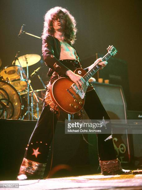 Jimmy Page of the rock band 'Led Zeppelin' performs onstage at the Forum on March 24 1975 in Los Angeles California