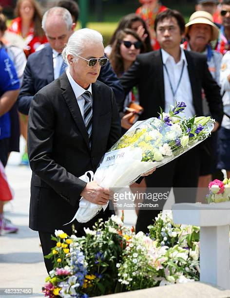 Jimmy Page offer a bunch of flowers at an altar of the Cenotaph for the ABomb victims at Hiroshima Peace Memorial Park on July 30 2015 in Hiroshima...