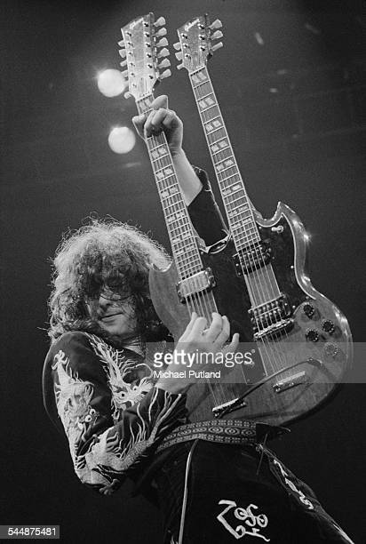 Jimmy Page playing a Gibson double neck guitar on stage with British heavy rock group Led Zeppelin, at Earl's Court, London, May 1975. The band were...
