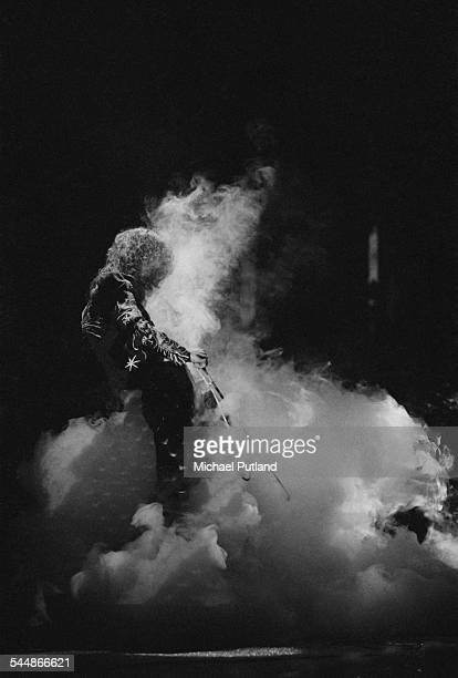 Jimmy Page playing his guitar with a violin bow on stage with British heavy rock group Led Zeppelin at Earl's Court London May 1975 The band were...