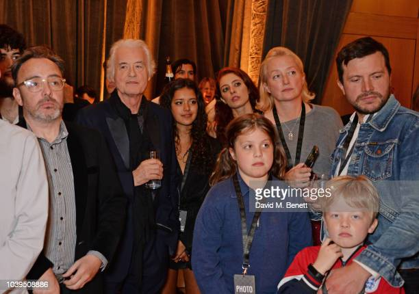 Jimmy Page poses with Dave Brolan Zofia Jade Page Scarlett Sabet Scarlet Page Tom Brown and guests attend the launch of Led Zeppelin by Led Zeppelin...