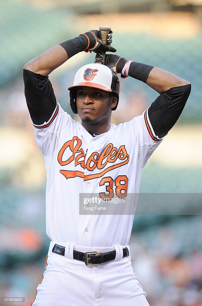 Jimmy Paredes #38 of the Baltimore Orioles reacts after striking out in the first inning against the Seattle Mariners at Oriole Park at Camden Yards on May 19, 2015 in Baltimore, Maryland.