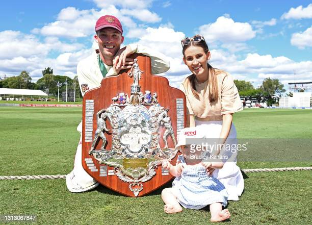 Jimmy Peirson of Queensland celebrates victory with wife Amy Peirson and daughter Evie during day four of the Sheffield Shield Final match between...